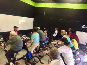Indoor cycling workout led by Sally the Head Heart